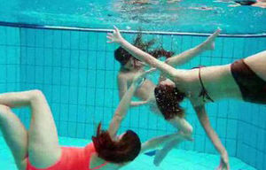 Three teen friends  in the swimming pool